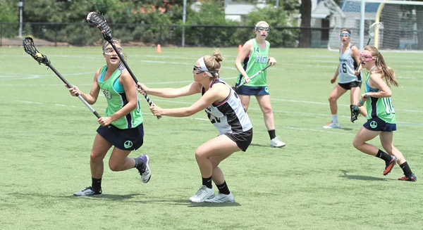Girls Elite team in action on field